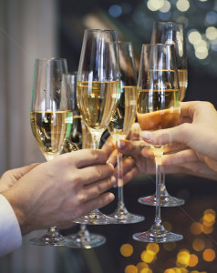 5178042_stock-photo-people-holding-glasses-of-champagne-making-a-toast